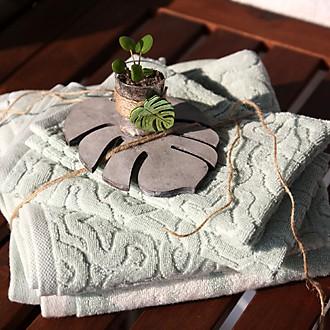 Handtücher verschenken Teaser Bild mit Blumendekoration