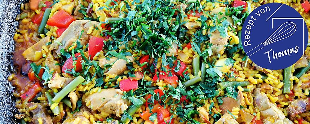 Paella mit Hühnchen und Meeresfrüchten Header